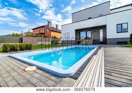 Pool In Luxurious House. Clean Water. View From The Floor. Up-to-date House With Open Porch And Gara