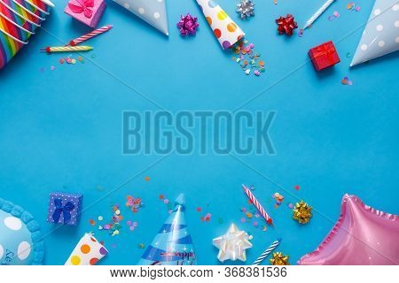 Flatlay Birthday Party Card On A Blue Background With Copy Space For Text.