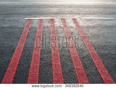 Red Rumble Strips On The Road. Sleeper Lines, Alert Strips, Audible Lines, Sleepy Bumps. Wake Up Cal