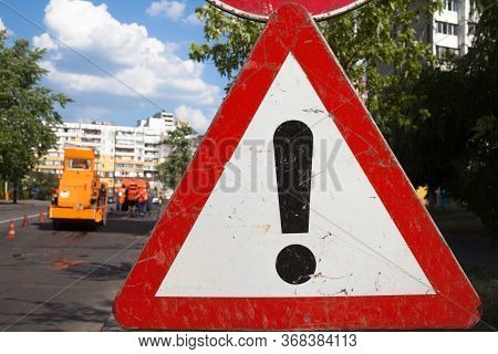 Other Dangers Sign. Dangerous Area. Traffic Sign. Road Works In The Background.