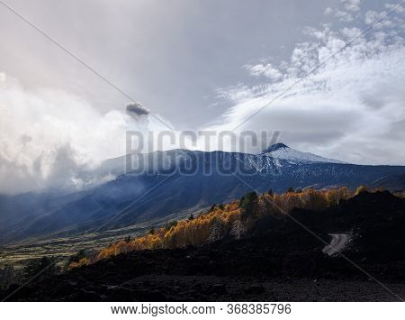Clouds Of Volcanic Smoke Passing Over Mount Etna Slopes And Hills In Sicily, Italy