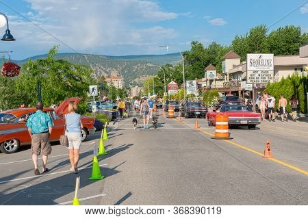 Penticton, British Columbia/canada - June 21, 2019: Vintage Cars And People Fill Lakeshore Drive For