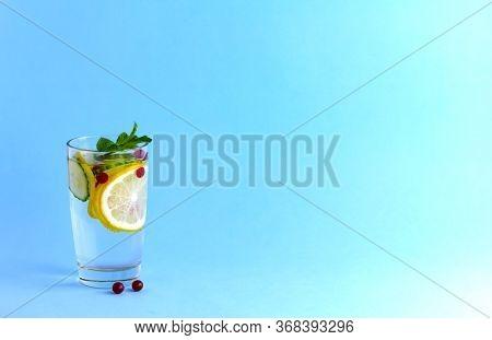 Sassy Diet Water. Cucumber, Lemon, Mint Lemonade In A Glass On A Blue Background