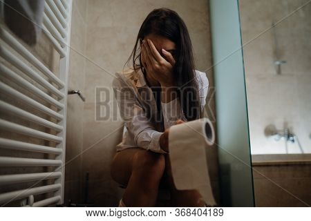 Disappointed Woman On The Toilet With Toilet Paper,suffering From Abdominal Pain.female Health Probl