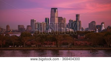 American East Cost. New Jersey State Jersey City Skyline During Scenic Sunrise. United States Of Ame