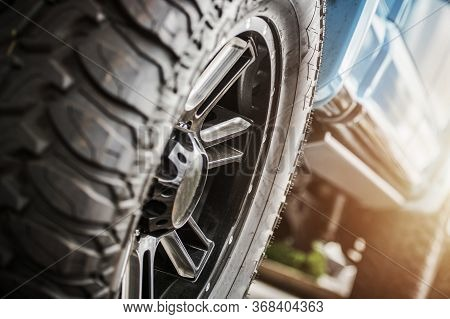 Performance Off Roading Theme. Deep Tread Of Off Road Tires To Provide More Traction On Unpaved Surf