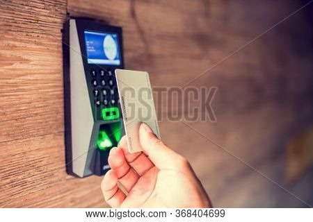 Door Access Control. Staff Holding A Key Card To Lock And Unlock Door At Home Or Condominium. Using