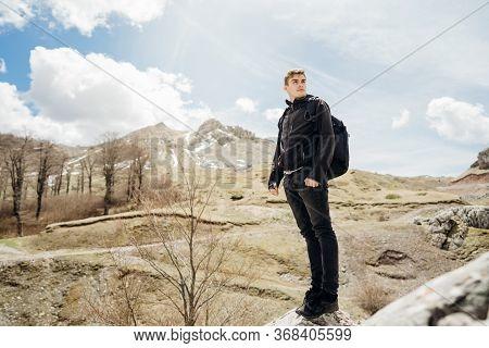 Young Backpacker Hiker Man Enjoying Adrenaline Mountain Hike.active Hiking Trip Vacation.climbing To