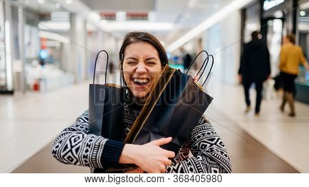 Excited Shoppingholic Woman In Shopping Mall.buying In Designer Store.wardrobe Sale Shopping.hoby Bu