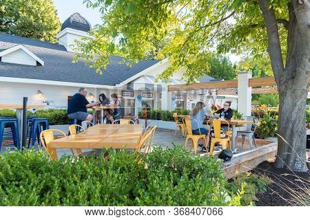 August 29, 2019 - Penticton, British Columbia/canada - People Enjoying A Meal On The Outdoor Patio A