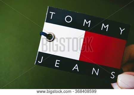 Closeup Of Tommy Hilfiger Label On Green Background . Hilfiger Denim. Tommy Hilfiger Detail.