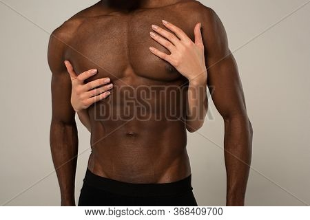 View Of Girlfriend Hugging Muscular Shirtless African American Boyfriend Isolated On Grey
