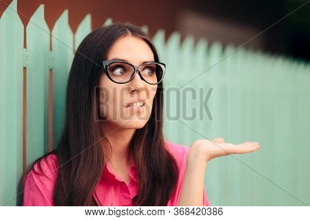 Quirky Woman Holding Her Hand Up For Presentation