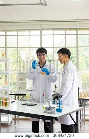 Science, Chemistry, Technology, Biology And Laboratory Concept - Asian Junior Scientist Is Showing E