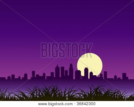night city silhouette with moon
