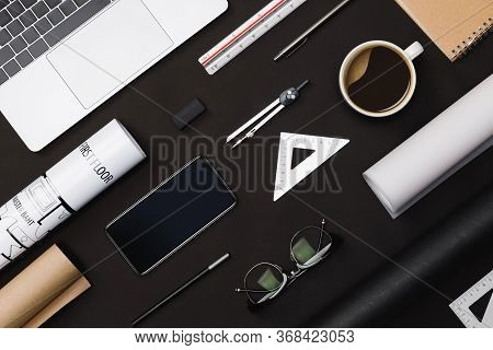 Creative Flat Lay Of Architects Black Table With Roll Blueprints, Architectural Project Plan, Engine