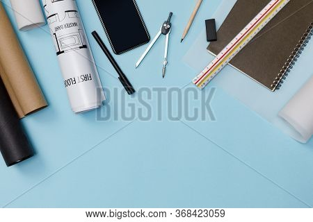 Creative Flat Lay Of Architects Blue Table With Roll Blueprints, Architectural Project Plan, Enginee