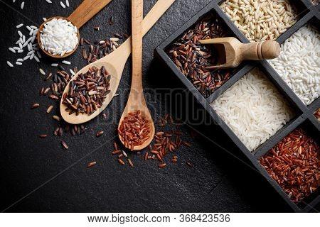 Organic White Rice, White Rice, Jasmine Rice, Black Rice, Brown Rice, Riceberry And Raw Rice In Wood