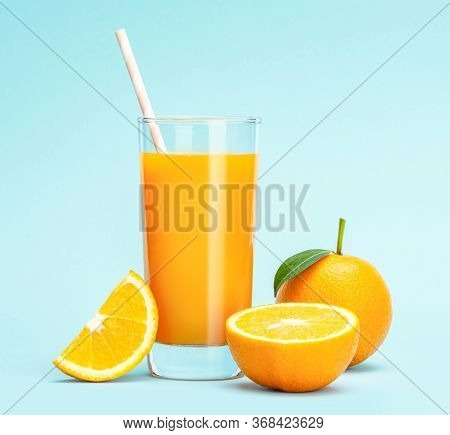 Glass Of Fresh Orange Juice On Wooden Table, Fresh Fruits Orange Juice In Glass With Group Of Orange