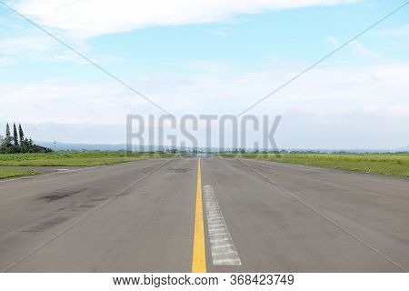 Airport Runway Airstrip In Afternoon. Empty Airport Terminal With Copy Space