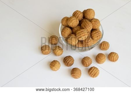 Round Ruddy Biscuit Dainty Dessert In The Form Of Small Balls. Cookies Are In A Transparent Glass Bo