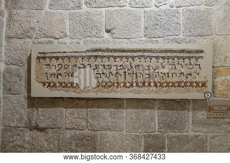 Jerusalem, Israel, January 25, 2020 : Partially Preserved Mosaic - Aramik Inscription From The Sinag