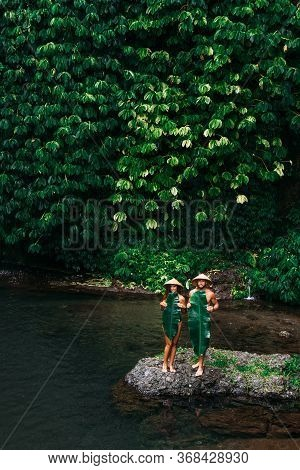 Couple Among The Greenery. A Couple In Love In The Tropics. The Couple Is Traveling In Asia. Beautif