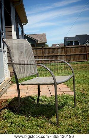Lawn Chiar In Residential Back Yard