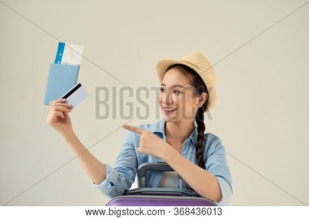 Beautiful Young Asian Woman Wear Hat With Showing Credit Card And Passport And Pointing To Travel Su