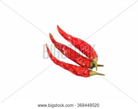 Three Red Chili Pepper Pods Isolated On White. Healthy Eating, Ayurveda, Naturopathy Concept