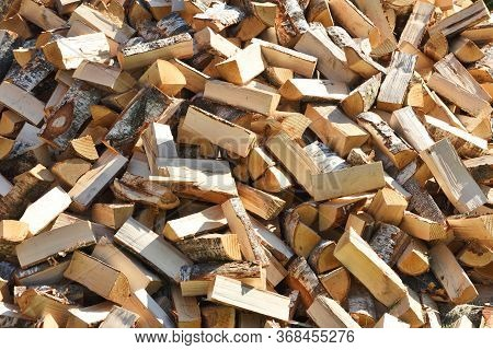 Preparation Of Firewood For The Winter. Firewood Background, Stacks Of Firewood. Pile Of Firewood.