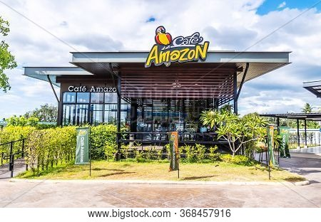Ranong, Thailand - Feb 11, 2020 : Cafe Amazon Coffee Shop With Nature Environment Against Blue Sky A