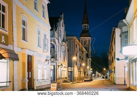 Parnu, Estonia - December 14, 2017: Night View Of Nikolai Street With Old Houses, Restaurants, Cafe,