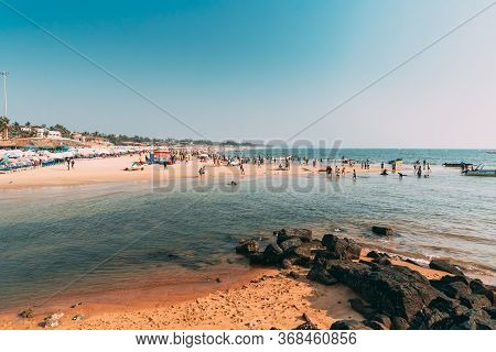 Mapusa, Anjuna, Goa, India - February 19, 2020: People Visit And Relax On Baga Beach At Sunny Evenin