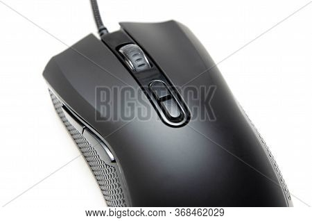 Black Gaming Mouse With Side Extra Keys And A Matte Finish On White Background. Mouse View From The