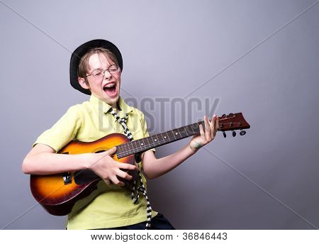 Teenager rocking out with a guitar