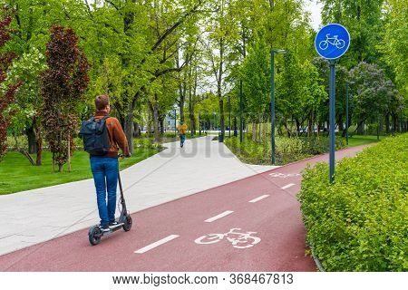 Sustainable Transport. Blue Road Sign Or Signal Of Bicycle Lane, Road Bike With Green Trees And Natu