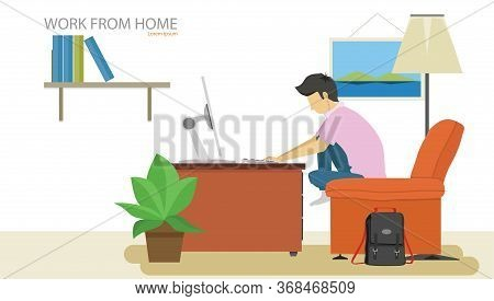 Man Sitting On Sofa Orange Color. Working Computer On Table. With Bag Black Colo Place Beside Sofa.