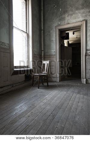 Lonely Chair In Lonely Room