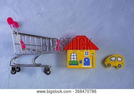 Shopping Trolley Basket Or Cart With House And Car In Pushcart. Choose Car And Housing Loan That Rig