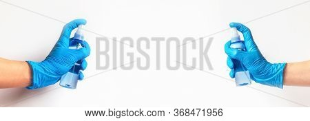 Female Hands In Blue Protective Glove Holding Plastic Bottle With Disinfector. White Background, Cop