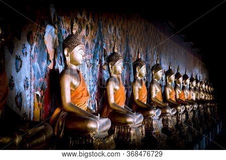 The Buddha At Wat Arun Bangkok Thailand To Buddhist Or Tourists Pay Homage.
