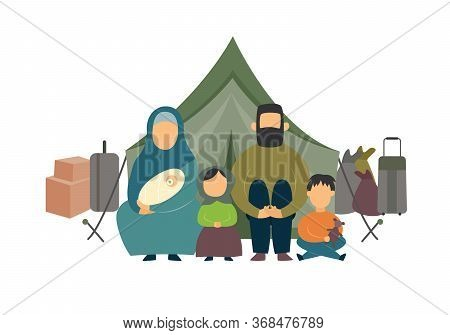Homeless Family Of Parents And Kids Sitting Near Luggage And Tent In A Refugee Camp.