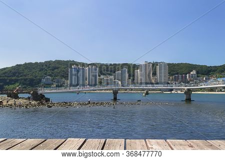 Busan, South Korea, September 14, 2019: View From Wooden Platform On Overwater Walking Bridge And Ci