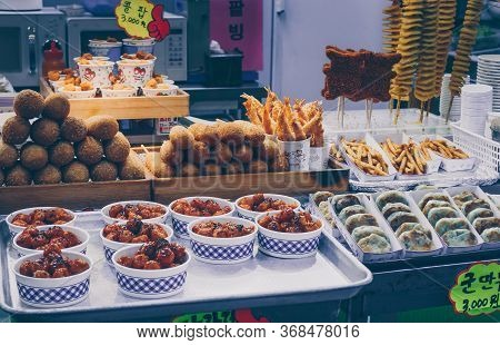 Busan, South Korea, September 14, 2019: Variety Of Korean Street Food On Display: Corn Dogs, Fries,