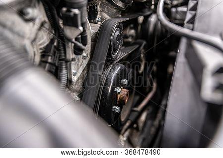 Fan Belt And V-belt Powering Alternator, Water Pump And Air Conditioner Compressor.