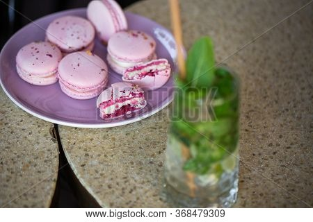 Macaroons On A Plate On A Gray Background. French Macarons Isolated. Selective Focus. Beautiful Pink