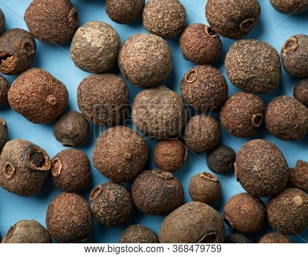 whole allspice isolated on white background. Aromatic allspice.
