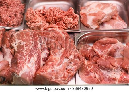 Heap Of Fresh Meat Food Meat Food Background In Supermarket Store. Different Types Of Raw Meat In Pl