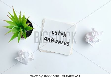 Catch Unawares - English Time Idiom Hand Lettering On Wooden Blocks.